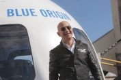 Jeff Bezos and his brother will fly on Blue Origin's first human spaceflight with auction winner