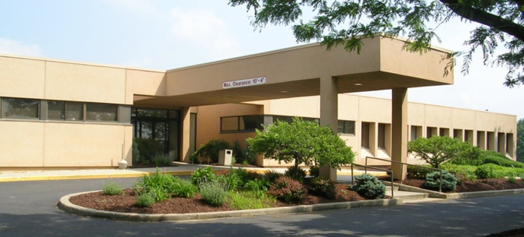 A tan-colored office building with is seen. PACS-related health care data breach.