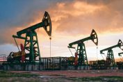 Working oil pumps are seen against a sunset sky. Intezer uncovered a year-long spear-phishing campaign against energy companies.