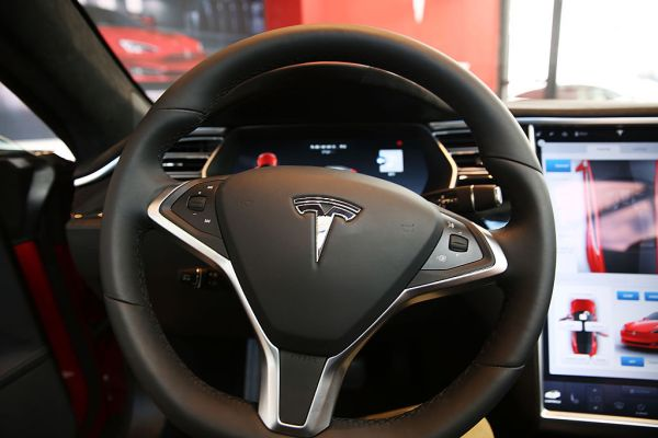 U.S. safety regulator opens investigation into Tesla Autopilot following crashes with parked emergency vehicles