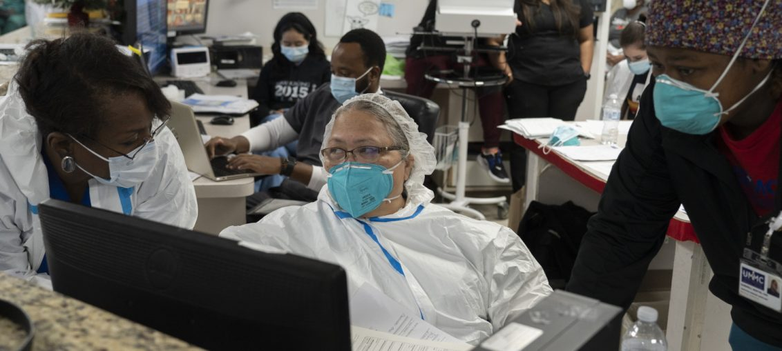 Medical staff members work in the COVID-19 ward nursing station at the United Memorial Medical Center on Dec. 29, 2020, in Houston.